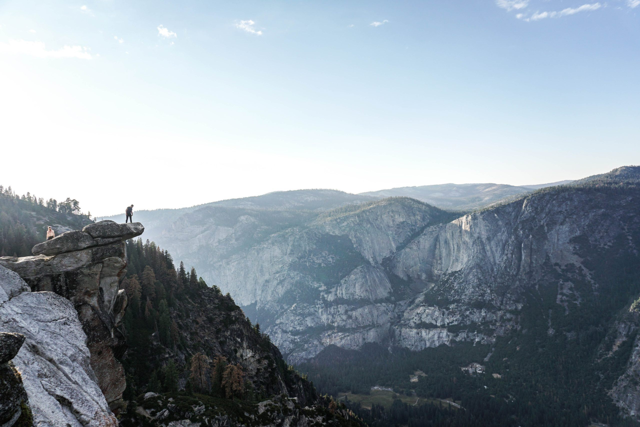 Sierra Ventures 2019 Year in Review - person standing on a mountain edge looking over a valley.